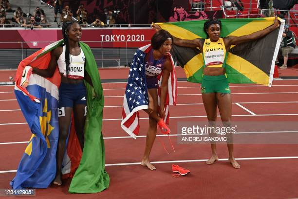 Second-placed Namibia's Christine Mboma, first-placed Jamaica's Elaine Thompson-Herah and third placed USA's Gabrielle Thomas celebrate after...