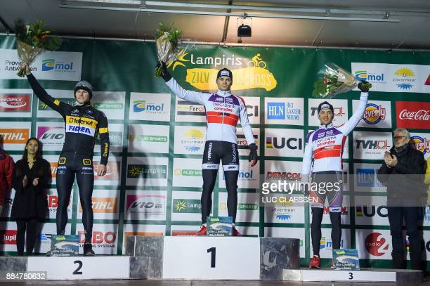 Secondplaced Netherlands' Corne Van Kessel winner Netherlands' David Van Der Poel and thirdplaced Belgium's Tom Meeusen celebrate on the podium after...
