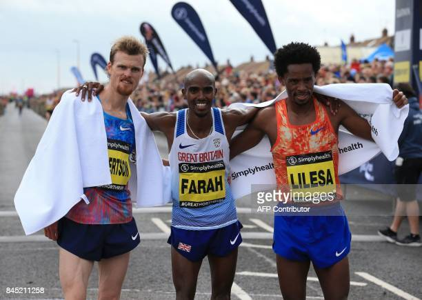 Secondplaced New Zealand's Jake Robertson winner Britain's Mo Farah and thirdplaced Ethiopia's Feyisa Lilesa pose at the finish line after finishing...