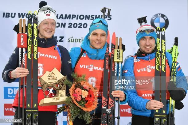 Secondplaced Norway's Johannes Thingnes Boe winner France's Emilien Jacquelin and thirdplaced Russia's Alexander Loginov celebrate on the podium...