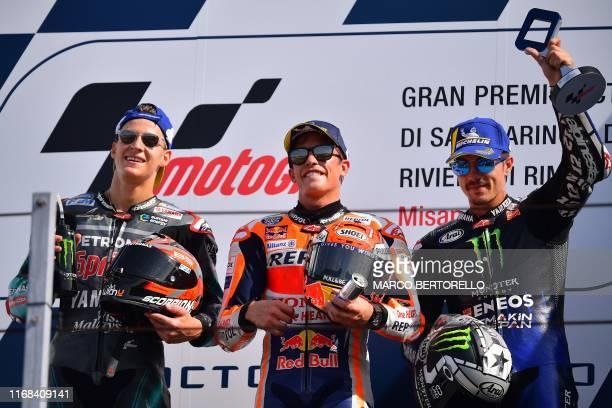 Second-placed Petronas Yamaha SRT French rider, Fabio Quartararo, race winner Repsol Honda Team Spanish rider, Marc Marquez and third-placed Monster...