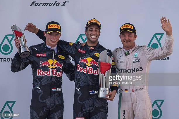 Second-placed Red Bull Racing's Belgian-Dutch driver Max Verstappen, champion Red Bull Racing's Australian driver Daniel Ricciardo and third-placed...