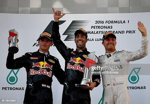 Secondplaced Red Bull Racing's BelgianDutch driver Max Verstappen champion Red Bull Racing's Australian driver Daniel Ricciardo and thirdplaced...
