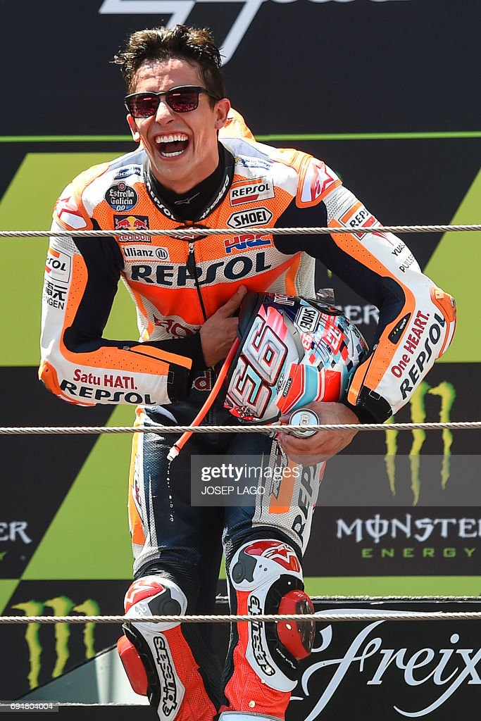 Second-placed Repsol Honda Team's Spanish rider Marc Marquez celebrates on the podium after the Moto GP race of the Catalunya Grand Prix at the Montmelo racetrack near Barcelona on June 11, 2017. / AFP PHOTO / Josep LAGO