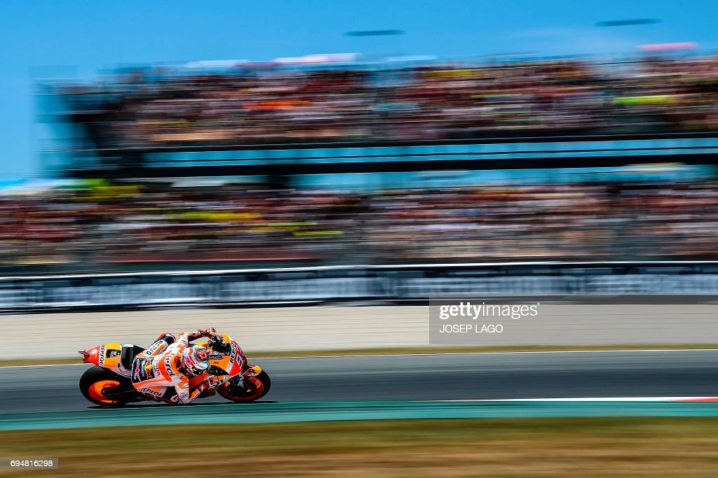 TOPSHOT - Second-placed Repsol Honda Team's Spanish rider Marc Marquez competes during the MotoGP race of the Moto Grand Prix de Catalunya at the Circuit de Catalunya on June 11, 2017 in Montmelo on the outskirts of Barcelona. / AFP PHOTO / Josep LAGO