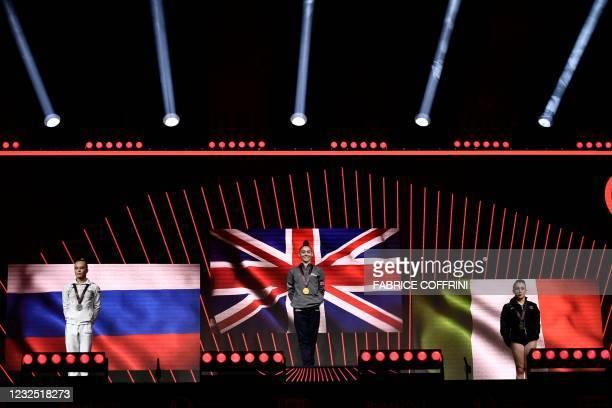 Second-placed Russia's Angelina Melnikova, first-placed Britain's Jessica Gadirova and third-placed Italy's Vanessa Ferrari celebrate on the podium...