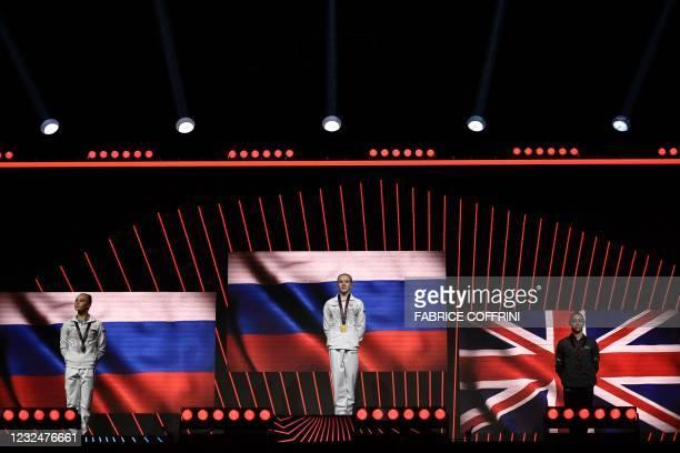 Second-placed Russia's Angelina Melnikova, first-placed Russia's Viktoriia Listunova and third-placed Britain's Jessica Gadirova celebrate on the...