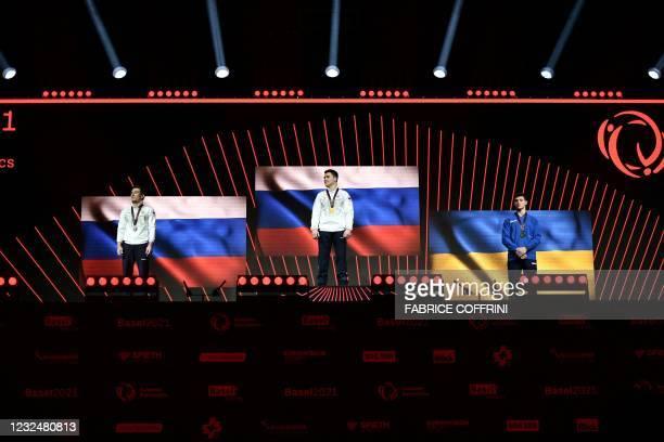 Second-placed Russia's David Belyavskiy, first-placed Russia's Nikita Nagornyy and third-placed Ukraine's Illia Kovtun celebrate on the podium during...