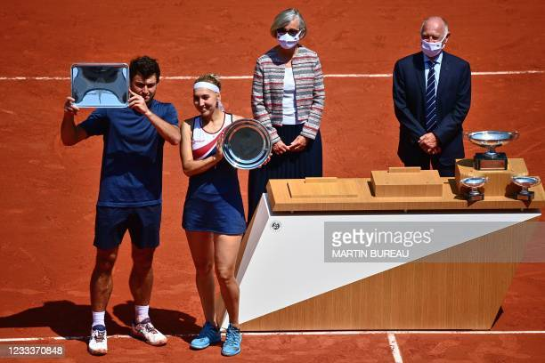 Second-placed Russia's Elena Vesnina and Russia's Aslan Karatsev , pose with their trophy after the mixed doubles final tennis match against Desirae...