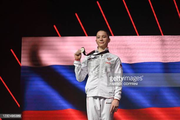 Second-placed Russia's Vladislava Urazova celebrates on the podium during the award ceremony after competing in the Women's uneven bars apparatus...