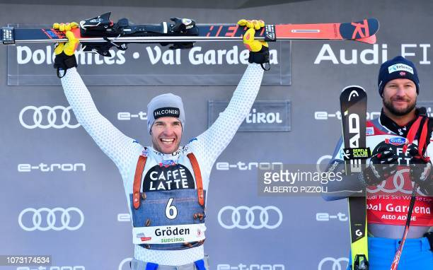 Secondplaced Secondplaced Italy's Christof Innerhofer and winner Norway's Aksel Lund Svindal celebrate on the podium after the FIS Alpine World Cup...