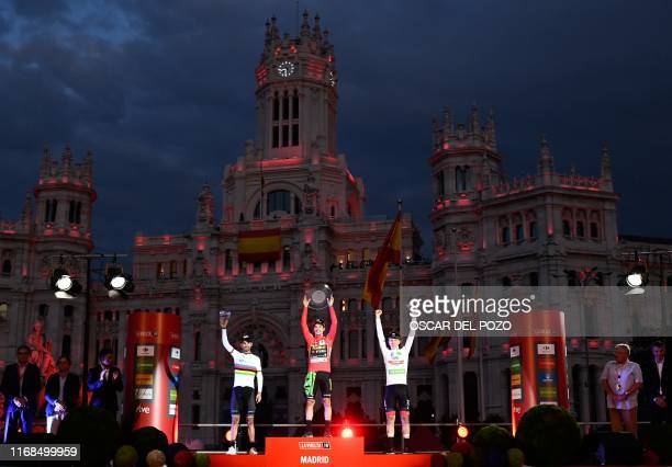 Secondplaced Team Movistar rider Spain's Alejandro Valverde winner Team Jumbo rider Slovenia's Primoz Roglic and thirdplaced Team UAE Emirates rider...