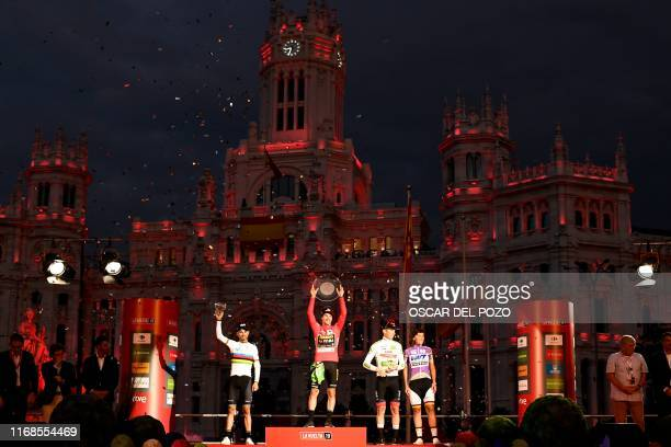 Second-placed Team Movistar rider Spain's Alejandro Valverde, winner Team Jumbo rider Slovenia's Primoz Roglic and third-placed Team UAE Emirates...