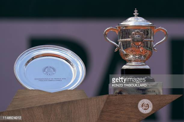 Second-placed trophy for Czech Republic's Marketa Vondrousova and the Suzanne Lenglen trophy for winner Australia's Ashleigh Barty are displayed...