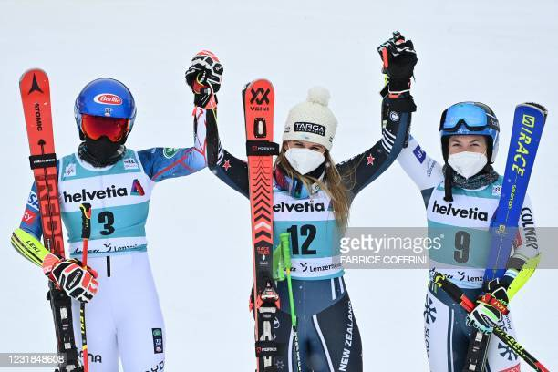 Second-placed US Mikaela Shiffrin, first-placed New Zealand's Alice Robinson and third-placed Slovenia's Meta Hrovat pose for pictures in the...