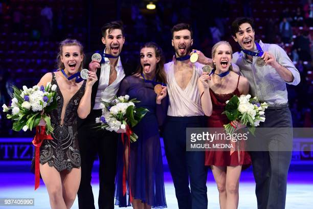 Secondplaced US silver medallists Madison Hubbell and Zachary Donohue firstplaced France gold medallists Gabriella Papadakis and Guillaume Cizeron...