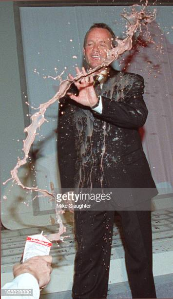 Seconds after Stockwell Day burst through some curtains in a grand entrance at his unveiling of the Alliance Party platform someond splattered him...