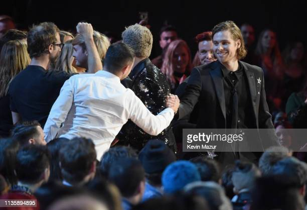 5 Seconds of Summer accept Best Duo/Group of the Year at the 2019 iHeartRadio Music Awards which broadcasted live on FOX at Microsoft Theater on...