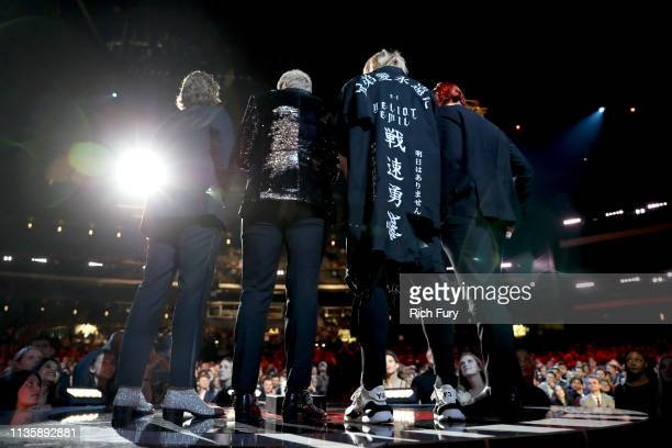 5 Seconds of Summer accepts Best Duo/Group of the Year onstage at the 2019 iHeartRadio Music Awards which broadcasted live on FOX at the Microsoft...