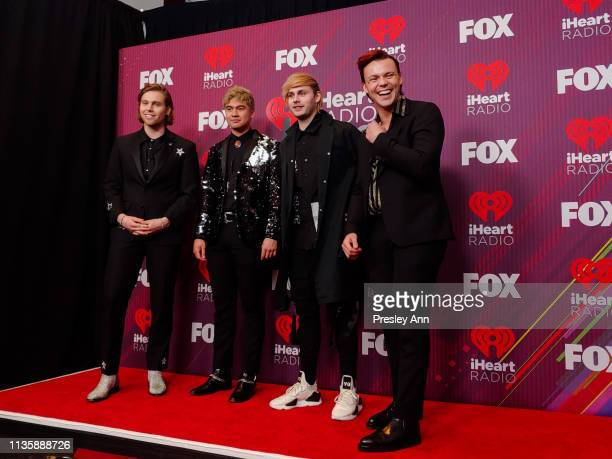 5 Seconds of Summer attends 2019 iHeartRadio Music Awards in the press room during the 2019 iHeartRadio Music Awards which broadcasted live on FOX at...