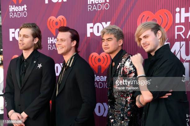 Seconds of Summer attends the 2019 iHeartRadio Music Awards which broadcasted live on FOX at the Microsoft Theater on March 14 2019 in Los Angeles...
