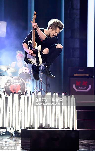 Seconds of Summer perform onstage at the 2014 American Music Awards at Nokia Theatre LA Live on November 23 2014 in Los Angeles California