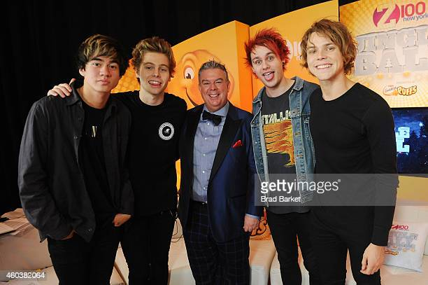 Seconds of Summer pose with radio personality Elvis Duran during iHeartRadio Jingle Ball 2014 hosted by Z100 New York and presented by Goldfish Puffs...
