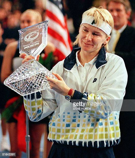 Secondseeded Jana Novotna of the Czech Republic holds her trophy for winner of the Chase Championships at Madison Square Garden 23 November in New...