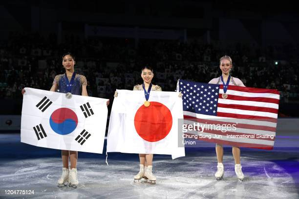 Seconf place Young You of South Korea first place Rika Kihira of Japan and third place Bradie Tennell of United States pose during the medal ceremony...