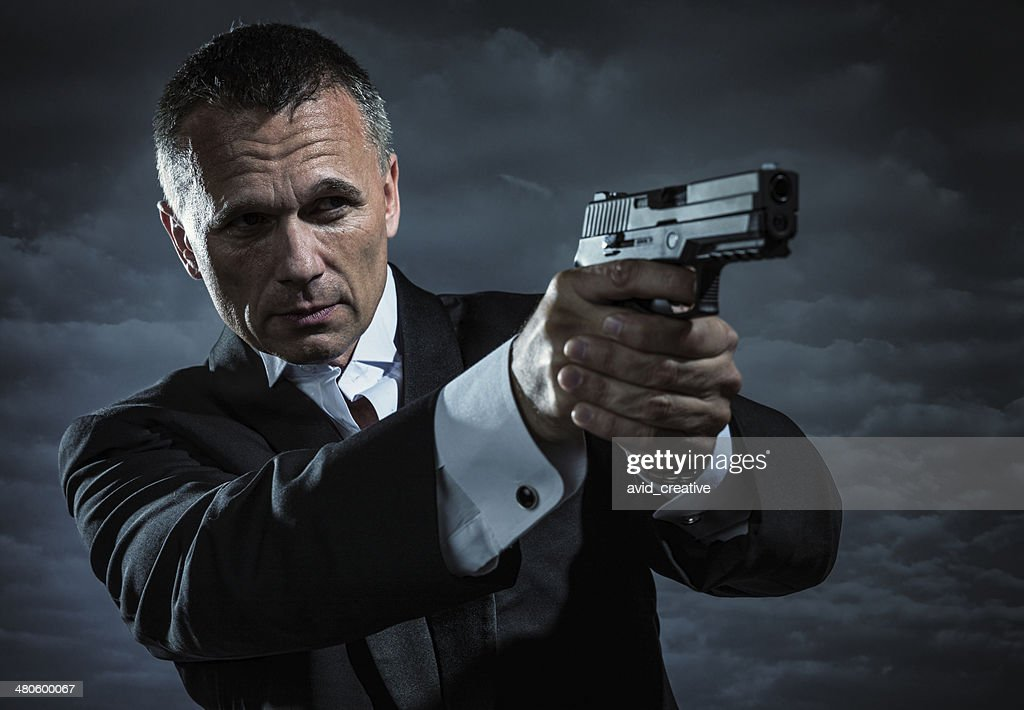 Secret Agent Armed With Handgun : Stock Photo