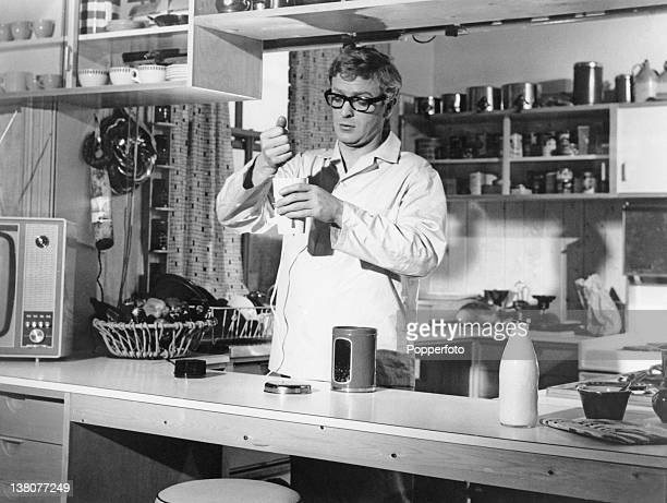 Secret agent Harry Palmer, played by Michael Caine, prepares to grind some fresh coffee for breakfast in a scene from 'The Ipcress File', directed by...