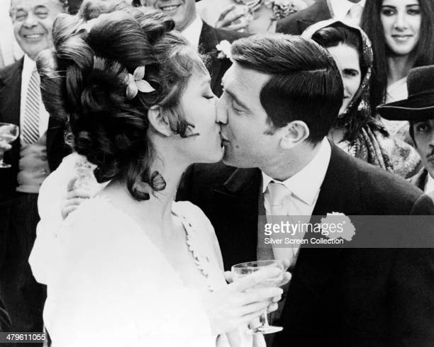 Secret agent James Bond and his new bride Contessa Teresa di Vicenzo/Tracy Bond kiss in the wedding scene from 'On Her Majesty's Secret Service'...