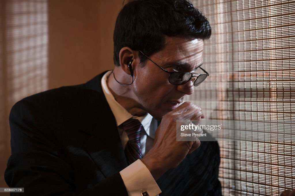 Secret agent on a stake out : Stock Photo