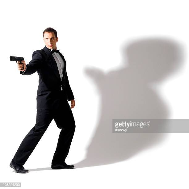 secret agent wearing tuxedo - spy stock pictures, royalty-free photos & images