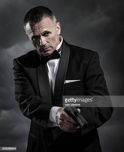 secret agent with handgun - secret agent stock pictures, royalty-free photos & images