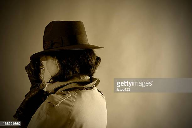 secret agent woman. 1940s style. sepia. old-fashioned. - secret agent stock pictures, royalty-free photos & images