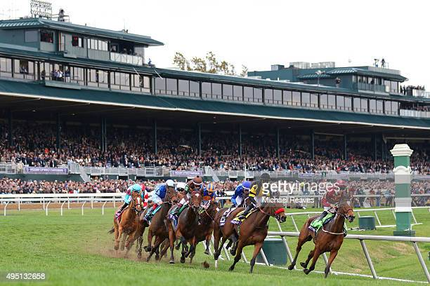 Secret Gesture, ridden by Florent Geroux lead the Breeders' Cup Fillies and Mare Turf Field around the first turn during Day 2 of the Breeders' Cup...