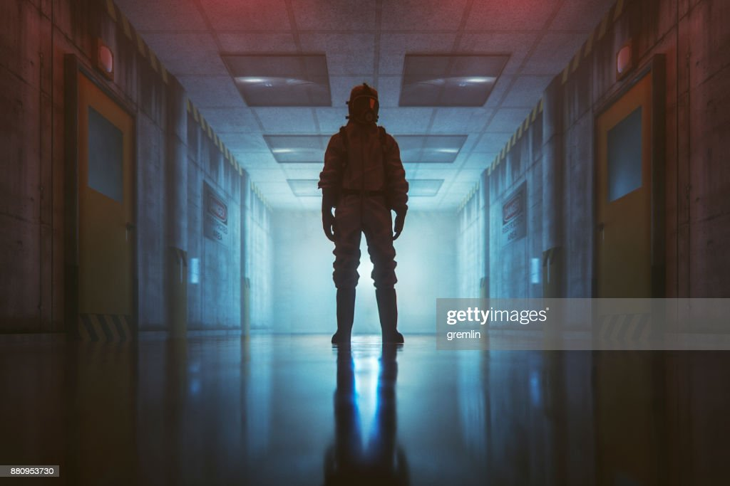 Secret government underground facility with standing man in hazmat suit : Stock Photo