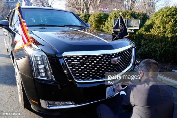 Secret Service agent changes the license plate on President Joe Biden's limousine near the North Portico of the White House, on January 20 in...