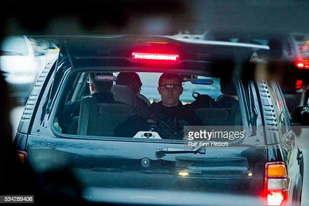 A Secret Service agent in the war wagon trails PresidentElect Barack Obama's motorcade as it winds its way thogh Chicago traffic