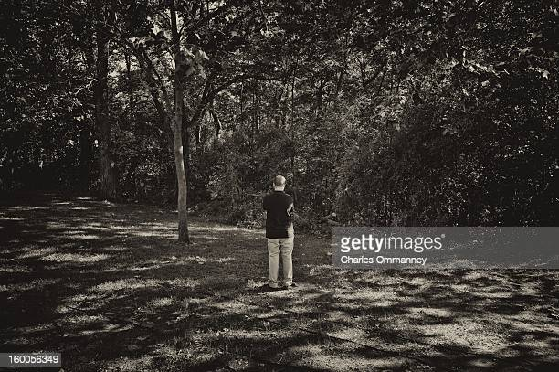 A Secret Service agent keeps an eye on the woods as US President Barack Obama delivers remarks during a campaign event at Herman Park in Boone Iowa...