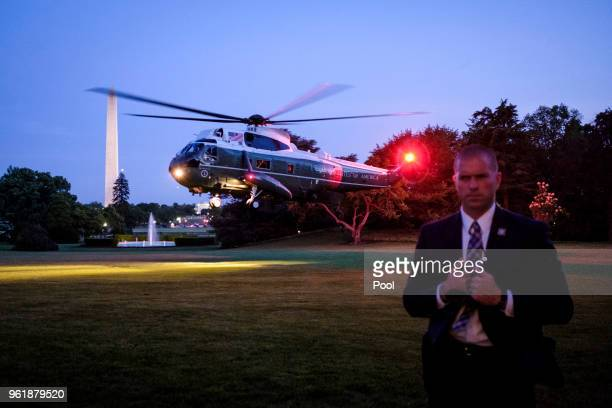 A Secret Service agent keeps watch as President Donald Trump arrives aboard Marine One on the South Lawn of the White House on May 23 2018 in...