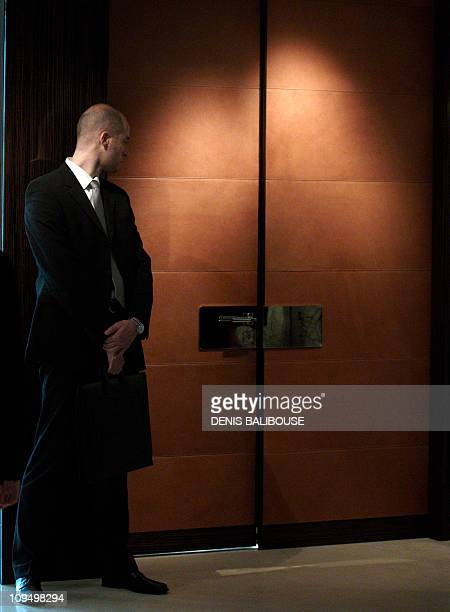 A secret service agent looks at a door while US Secretary of State Hillary Clinton holds a bilateral meeting in Geneva on February 28 2011 Clinton...