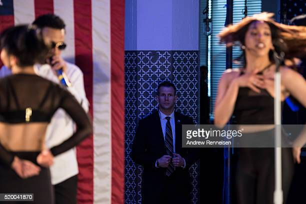 A secret service agent looks on while Puerto Rican singersongwriter Toby Love performs during a Latino organizing event held by Democratic...