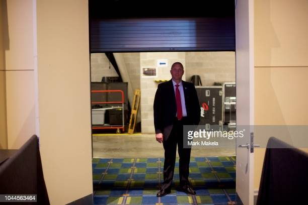 Secret Service agent monitors activity near the stage before President Donald Trump addresses the National Electrical Contractors Convention on...