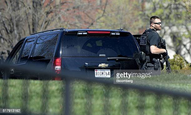 A US Secret Service agent patrols the North Lawn of the White House after reports of shooting at the Capitol building in Washington DC US on Monday...