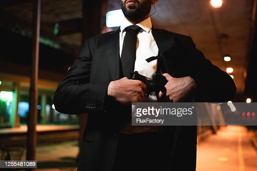 Secret Service Agent Pulling Out His Gun High Res Stock Photo Getty Images
