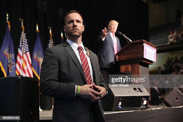A secret service agent scans the crowd as Republican presidential candidate Donald Trump speaks to supporters on July 27 2016 in Scranton...