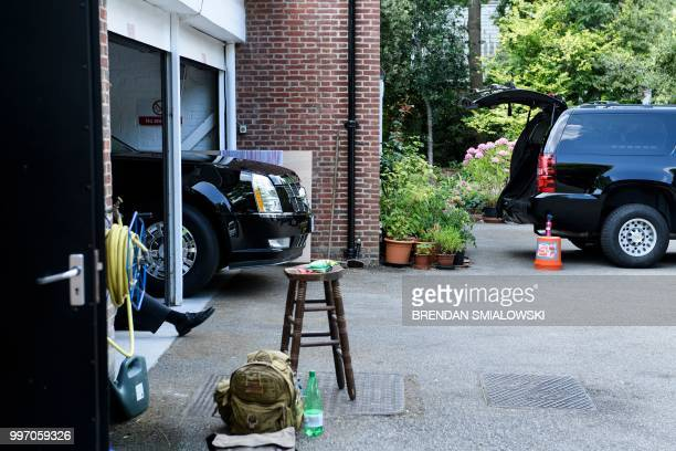 A Secret Service agent sits with one of US President Donald Trump's armored limos at the US ambassador's residence Winfield House in London on July...