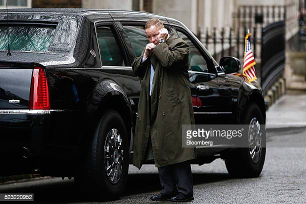 A secret service agent speaks into a mouthpiece on Downing Street in London UK on Friday April 22 2016 US President Barack Obama will urge Britons on...
